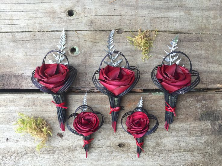 Red & black buttonholes with silver fern. www.flaxation.co.nz