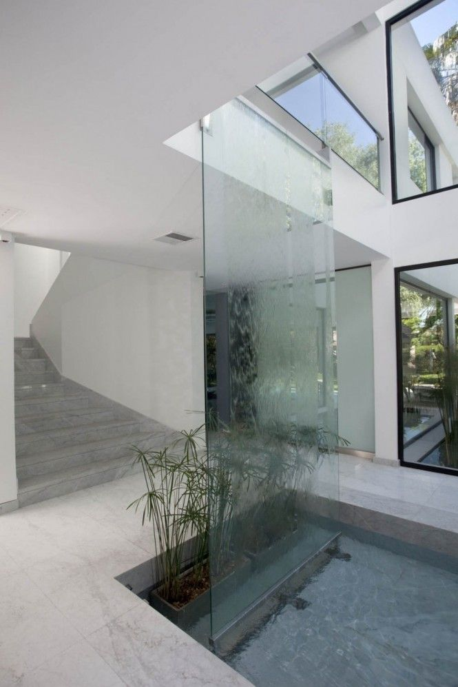 waterfall - would LOVE somehthing like this in an entryway, especially if it connected to a kind of stream in the floor under glass, running though the common space and into a courtyard