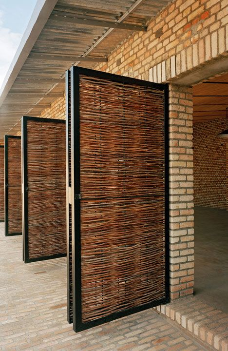 Education centre in Rwanda built from brick and wicker by Dominikus Stark Architekten