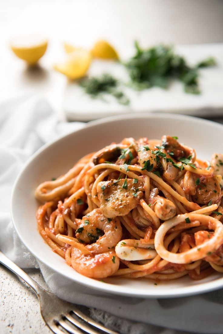 An easy seafood pasta recipe - classic Spaghetti Marinara. Pasta tossed in a luscious tomato sauce with mixed seafood - incredibly fast & easy to make!