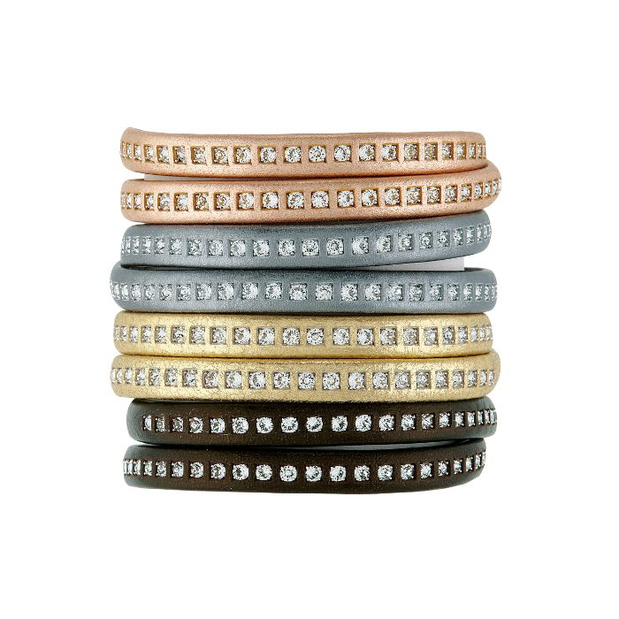 Glam up your outfit this Christmas! An alluring leather bracelet with a shimmer of glam that is very versatile.