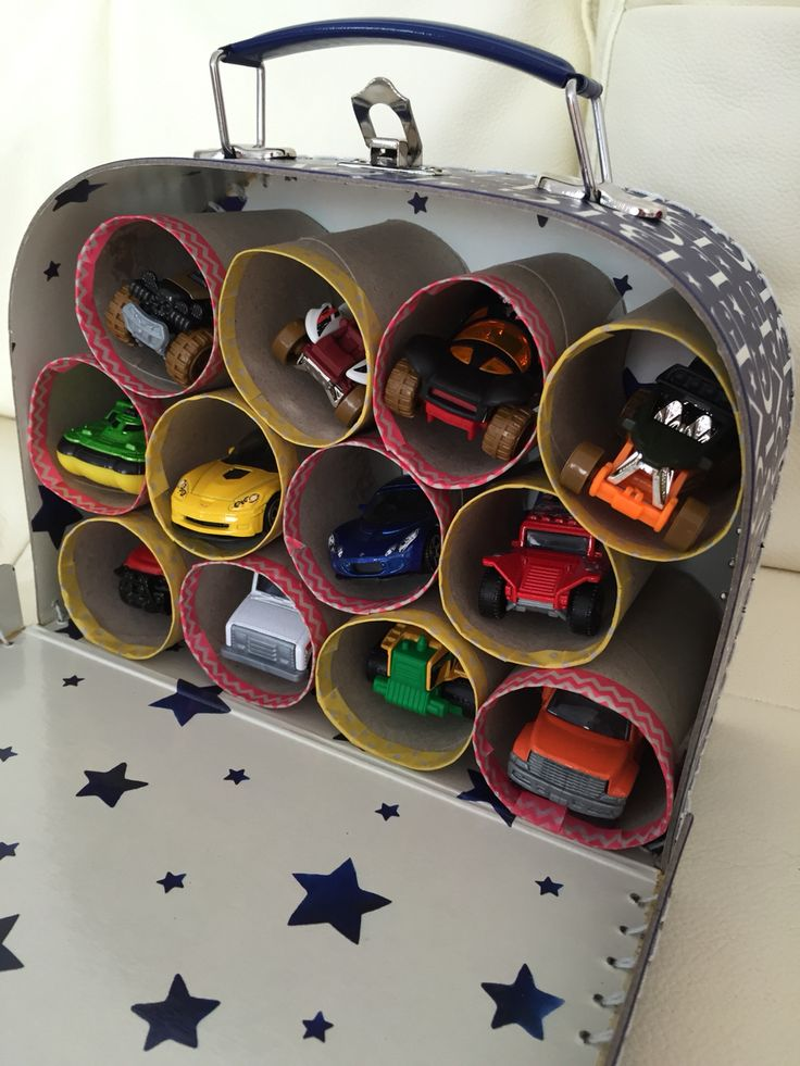 Parking garage for toy cars - made from a cardboard suitcase, loo rolls, washi tape and cars!