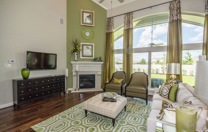 Do you like the splashes of green used in this two-story living space?