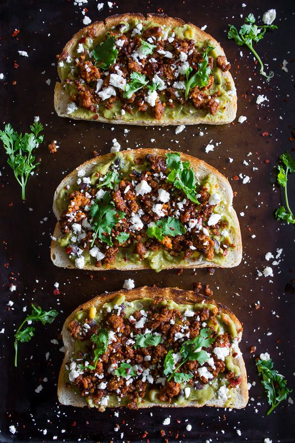 This chorizo cotija guacamole toast is a great way to start the day. Guacamole mixed with vegetables and topped with chorizo, cotija and cilantro.