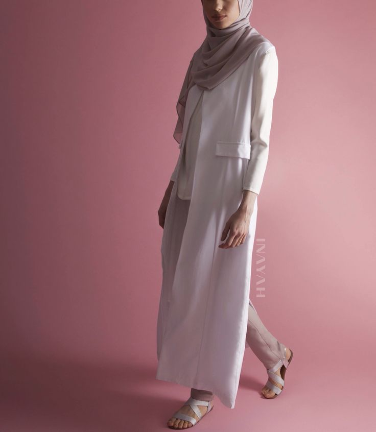Step into the new season with our modest summer looks: White Sleeveless #Coat + White Crepe #Top + Mushroom Straight Leg #Trousers + Washed Lilac Soft Crepe #Hijab - www.inayah.co