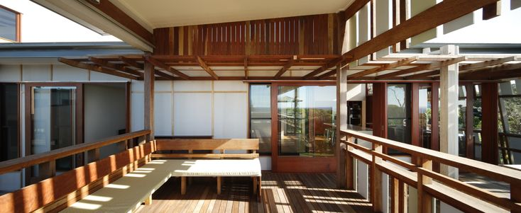 This is a Beach House we did at North Strabroke Island. The house is counter intuitively arranged with living to the north west. This maximises the views to the north while allowing for all year round living protected from the south east weather. The house consists of 2 pavilions flanking a central courtyard. The west is protected by a patterned screen providing filtered light, western sun protection and a skirt to the raised floor from the street.