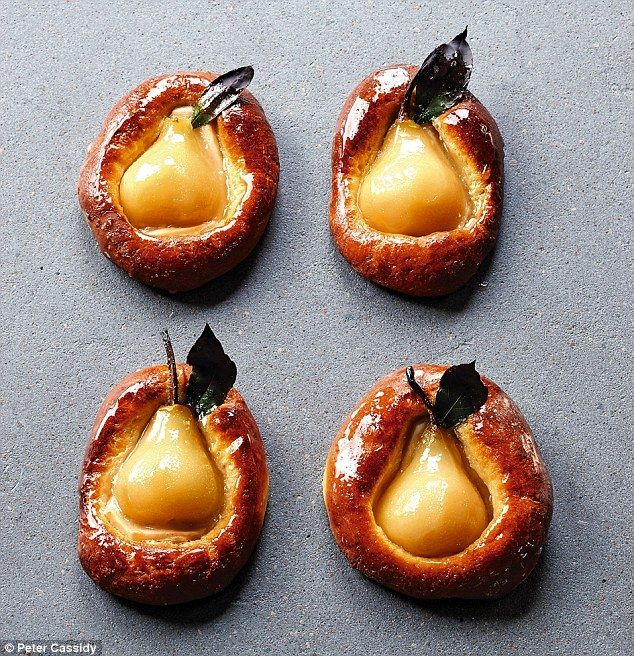 Poached pear halves baked in brioche with caramel sauce