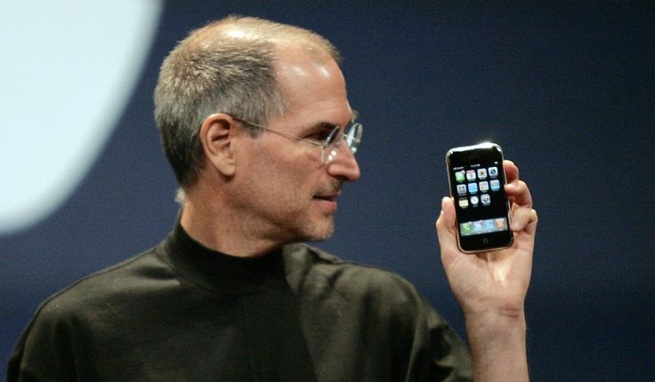 Apple Computer Inc. Chief Executive Officer Steve Jobs holds the new iPhone in San Francisco, California January 9, 2007. Apple unveiled an eagerly-anticipated iPod mobile phone with a touch-screen on Tuesday, priced at $599 for 8 gigabytes of memory, pushing the company's shares up as much as 8.5 percent. Jobs said the iPhone, which also will be available in a 4-gigabyte model for $499, will ship in June in the United States. The phones will be available in Europe in the fourth quarter and…