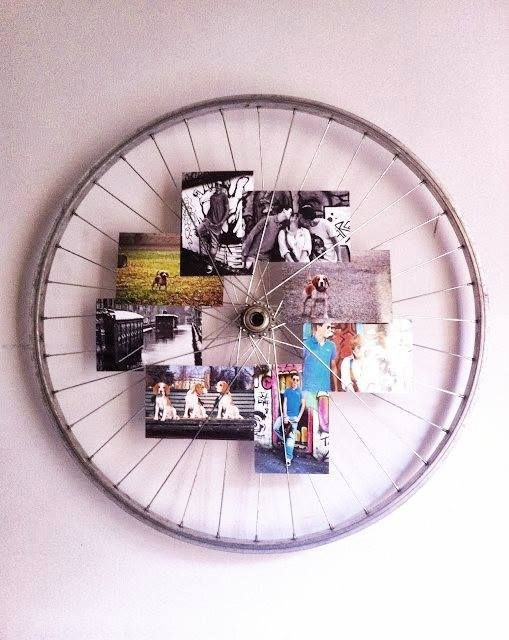 Bike wheel recycled into a picture holder.