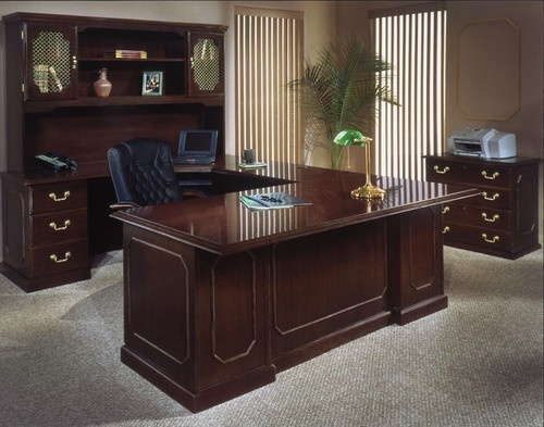 Traditional styling is shown in the attention to detail with the Governors Series reception desks. It offers an expansive office furniture line in an engraved executive mahogany finish. The Governors office furniture will fit any business environment.