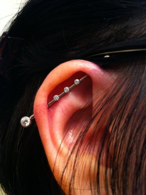 Girly industrial piercing with crystals. on The Fashion Time http://thefashiontime.com/5-cute-fun-ear-piercing-ideas/#sg12