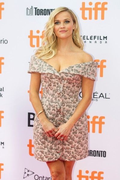 Reese Witherspoon poses for photographs at the premiere of 'Sing' at the Toronto International Film Festival.