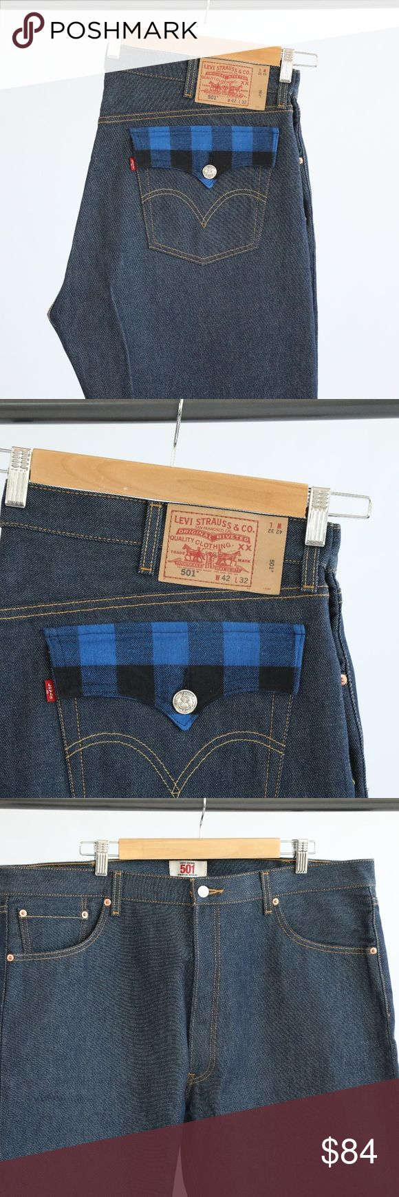 """Levi's Original 501 Straight Leg Button-Fly Jeans Levi's Original 501 straight leg button-fly jeans. 100% cotton. Blue and plaid pocket fold detailing on back. Buttons have light discoloration. Dark wash with gold colored stitching. 32"""" inseam on the pants. Levi's Jeans Straight"""