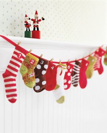 Wonderful things come in small packages. This hanging Advent calendar assembled from baby socks is full of great things, and it's the perfect way to mark the season for a baby or an older child.