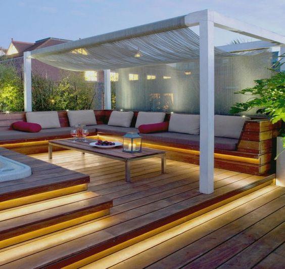 rustic deck pergola with creative lighting