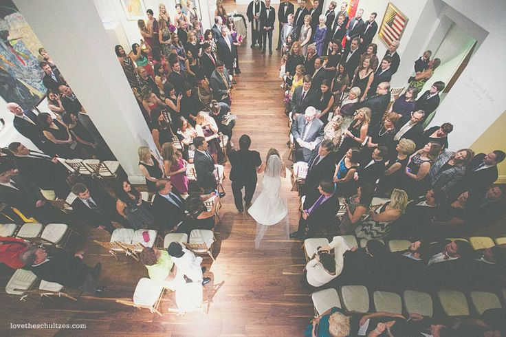Love this shot of bride and father of the bride walking down the aisle!  Art gallery wedding - so elegant and sophisticated!  Ben Keys Live Wedding artist Foundation for the Carolinas - Charlotte, NC Wedding Photography by The Schultzes - www.lovetheschultzes.com