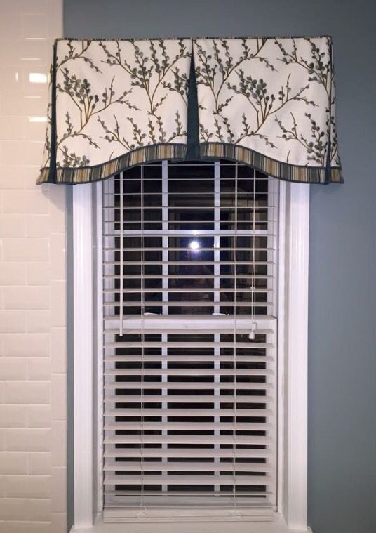 Custom board-mount valance with contrast banding and piping