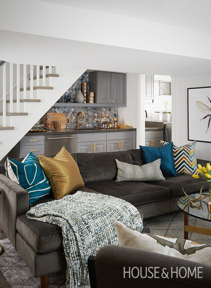 See how designer Erin Feasby of Feasby & Bleeks Design transforms a family basement into a hardworking space that maximizes style and square-footage. | Photo: Alex Lukey