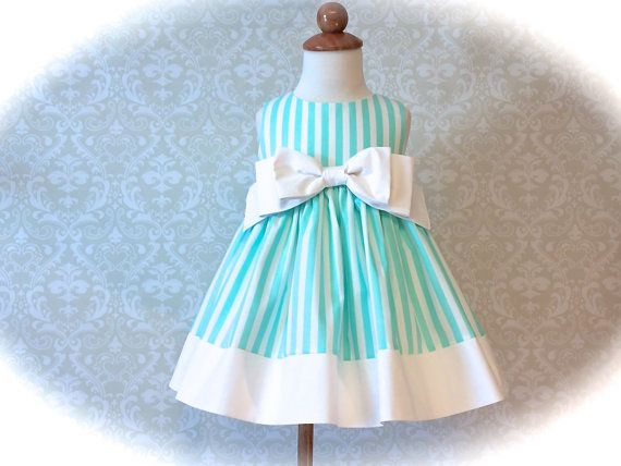 For special occasions, church, weddings, or Easter, this girls or toddlers aqua striped dress is available in sizes 2T - 6. Classic in style, with a