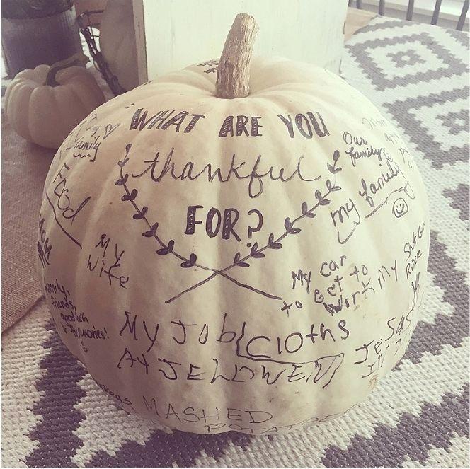 A white pumpkin doubles as a fall centerpiece and a record of Thanksgiving gratitude.