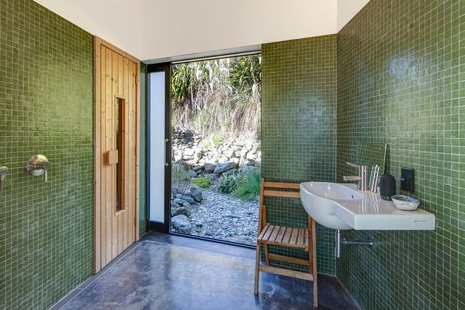 A glass door slides open to the guest bathroom and sauna. #houseoftheday