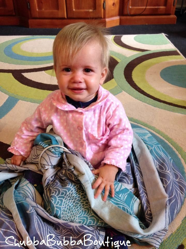 Adorable Little Birthday Girl with her Mermaid Ring Sling