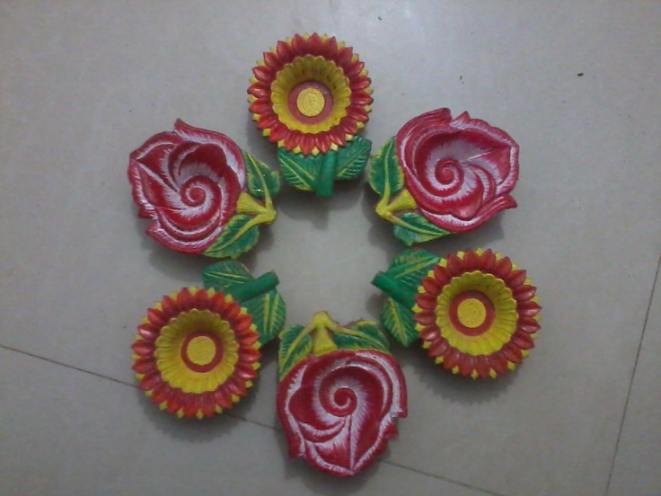 Hand painted floral diyas by our facebook FeviArtist.