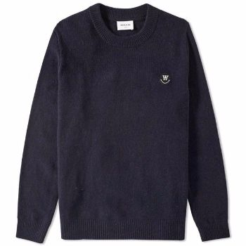 Wood Wood Dark Navy Yale Sweater : Dark navy Yale sweater by Wood Wood. This wooly jumper is great for colder months, whilst nodding towards the Ivy League with the ribbed hem and cuffs.