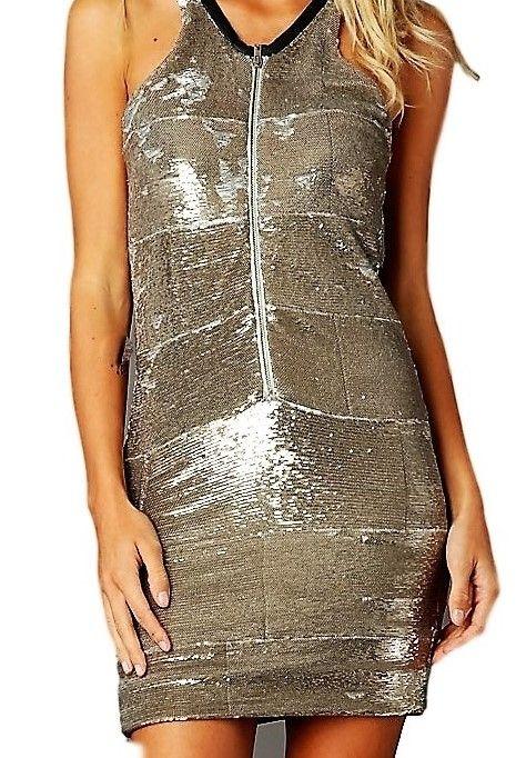 A louer sur La Fashion Lib : Robe Iro - robe paillette or doublée, emmanchures américaines devant et dos, gros zip devant pour ajuster le décolleté