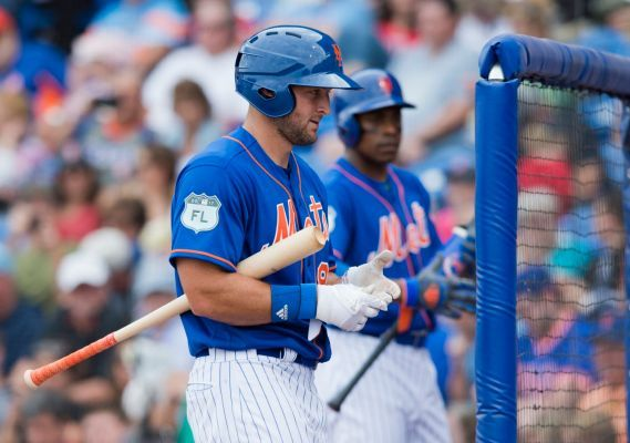 Mets' Tim Tebow gets standing ovation as run scores on his double-play groundout  -  March 8, 2017:   New York Mets designated hitter Tim Tebow walks back to the dugout during a spring training baseball game against the Boston Red Sox in the sixth inning on Wednesday, March 8, 2017, at First Data Field in Port St. Lucie, Florida. Photo Credit: AP / Molly Bartels
