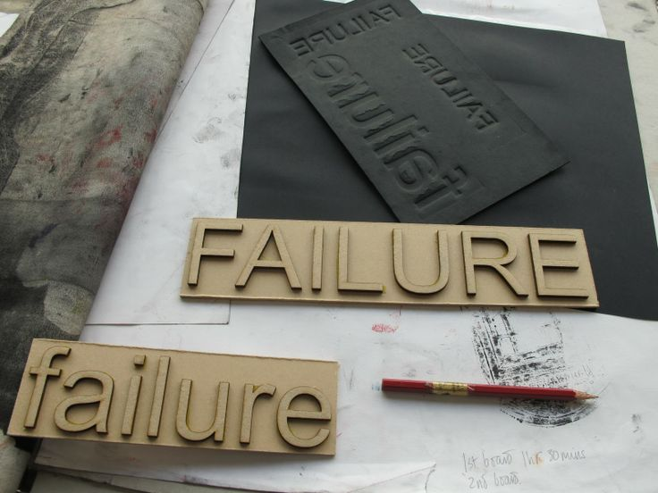 using cardboard letters to create an embossed effect