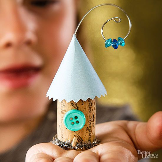 Kids will be in a twitter when they see these adorable cork birdhouses. Use glue to attach a paper cone to a cork; secure with a clothespin until dry. Wrap base of cork with metallic pipe cleaner. For the bird post, insert a toothpick into cork and trim the pointy end. Glue a small button above the toothpick. Bend a 5-inch piece of 20-gauge wire into a hanging loop and thread on three beads. Push other end of the wire through the paper roof into the cork as shown.