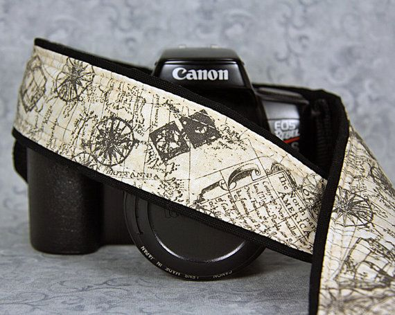 This camera strap has a old world map with a nautical theme. Colors include taupe on a creamy parchment colored background. All cotton fabrics are