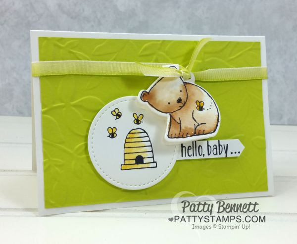 Baby card idea featuring Stampin' UP! A Little Wild bear stamp and matching Little Loves framelit dies.  Bee Hive and bees stamped on Stitched Shape framelits. Layered Leaves embossing folder background. Card by Patty Bennett