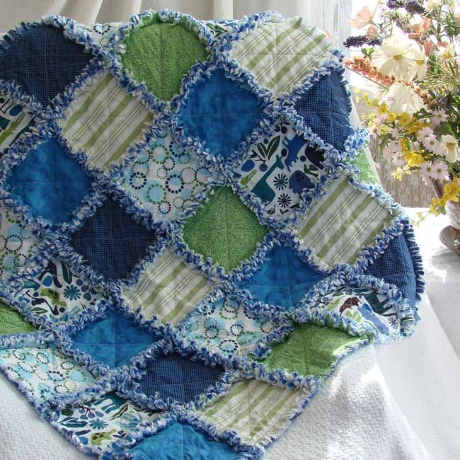 How sweet is this baby rag quilt? Colorful blue and green compliment the fun jungle animal print. Your baby's room will be a happy place to be with this colorful handmade baby quilt. A Quilts Just ...