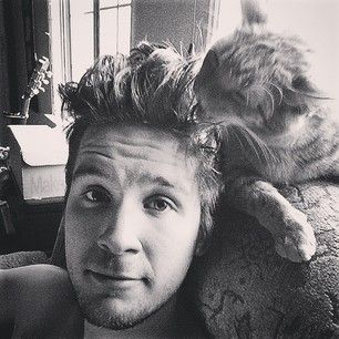 """And here he is with a cute cat. 