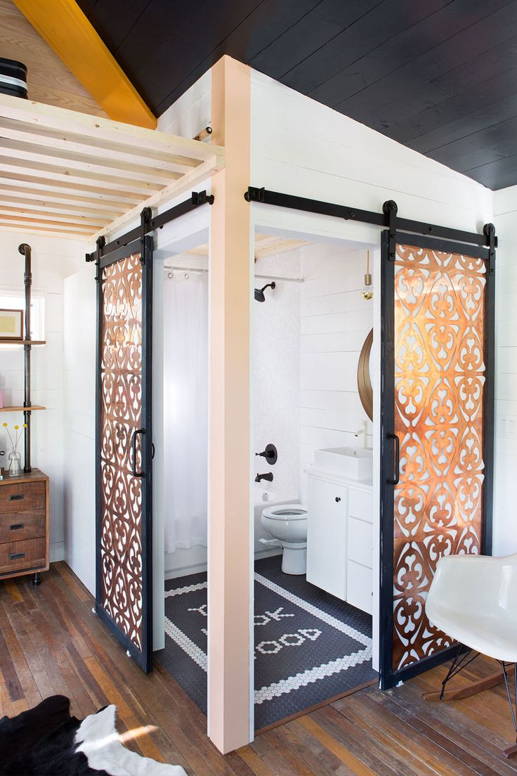 400 sq.ft. Small Boho-style House in Austin - it's two tiny houses on wheels put together. Check-out this bathroom - the double barn doors!