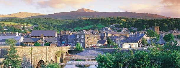 Dolgellau: Handsome, dark-stoned market town set beneath Cadair Idris, the legendary 'Chair of Idris'. Its narrow streets and open main square are home to a good range of inns and shops.