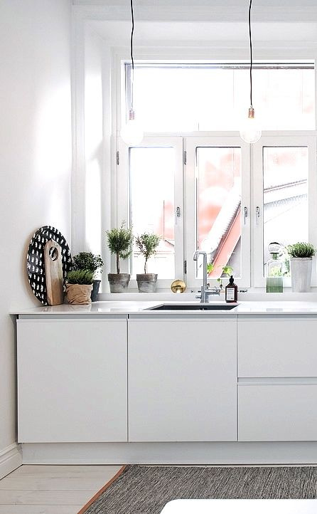 Via NordicDays.nl | White Alvhem Home | Minimalistic Kitchen