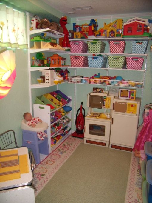 Small but Organized Playroom, Check out picture #5, the BEFORE picture. When we removed 2 huge hot water heaters from a dark corner in the b...