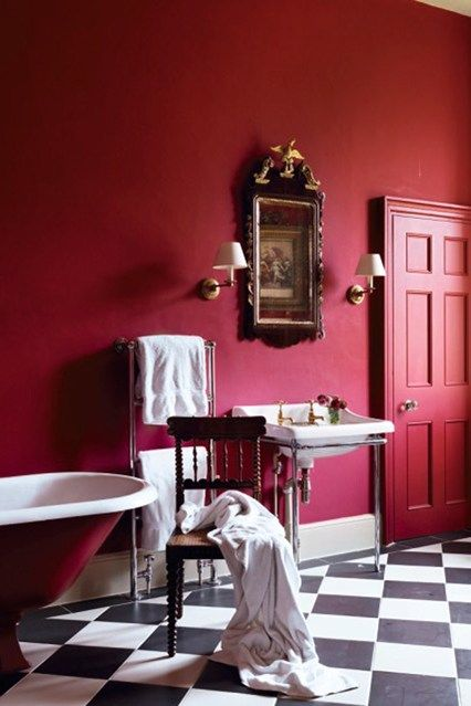 Knole, Kent, England. Red painted bathroom in family quarters of the Sackville-Wests within the 15thC-16thC National Trust property. House & Garden UK, June 2010. Photo.: Simon Brown.