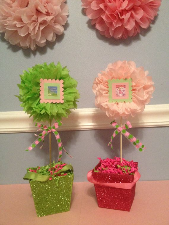 Childrens Book theme floral tissue pom pom topiary centerpiece Baby Shower/Bridal Shower/Birthday/Wedding via Etsy Now this is a nice idea using the poms!