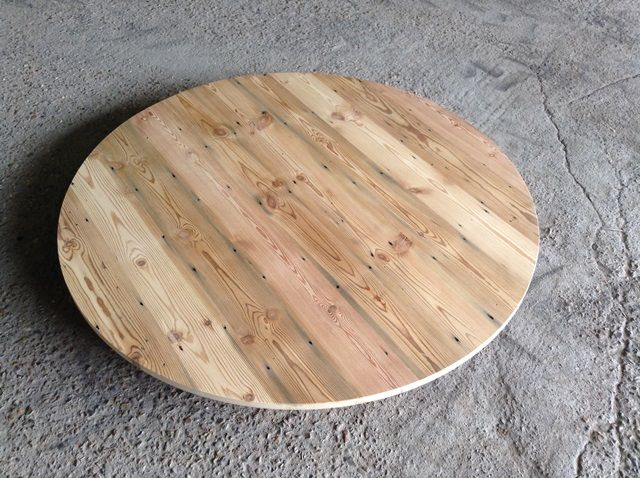Reclaimed pine boards used to create a large table top from salvaged timber