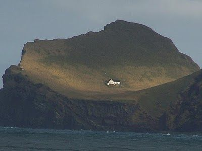 A teeny house perched on a cliff in Ellidaey (southern island in Iceland). I could totally imagine doing extreme rolling down the hill at night :)