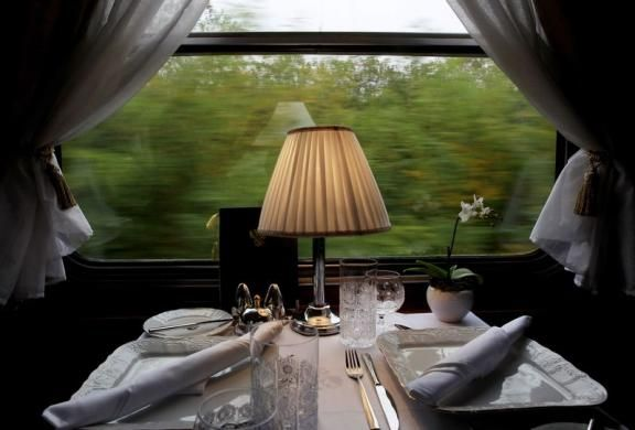 A table set for lunch is seen aboard a historic Tehran-bound train as it leaves Budapest October 15, 2014. REUTERS/Bernadett Szabo visit http://www.budpocketguide.com #Iran #Persia #Tehran #Budapest #TravelToIran #MyIran #Travel2Budapest #MyBudapest