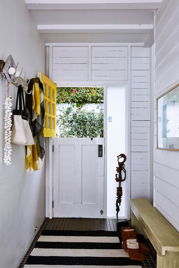 Entrance from a post-war weatherboard home on Sydney's northern beaches has been transformed with rustic coastal style. Photo: Scott Hawkins | Story: homes+