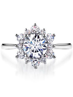This extreme halo features larger diamonds encircling the center stone to create a dazzling snowflake effect.
