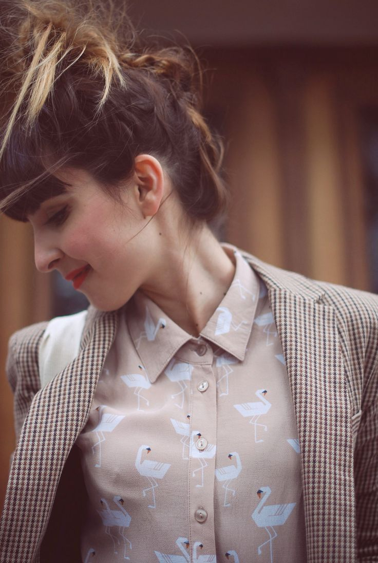 How to keep a suit jacket casual and quirky with a printed blouse. Those stylized swans are pretty cool by the way