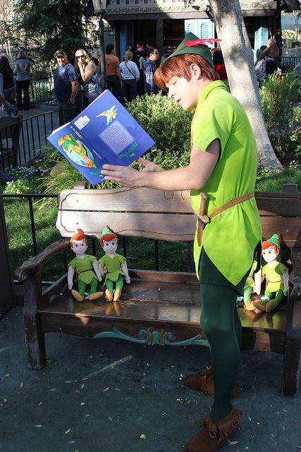 """Peter reading """"Peter Pan"""" to the Peter Pans ~ The book's upside down...Hilarious! Gotta love Peter  Lol!"""