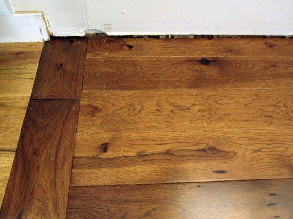 transition between different wood floors....need to find a way to transition the dark wood floors of my living room with the rustic natural wood floors I want in the kitchen and dining rooms.